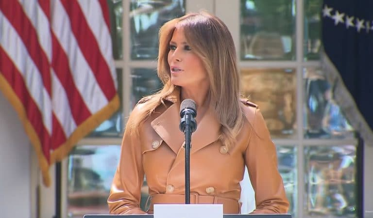 """Protesters Await Melania As She Arrives At Boston Medical Center As Part Of Her """"Be Best"""" Campaign"""