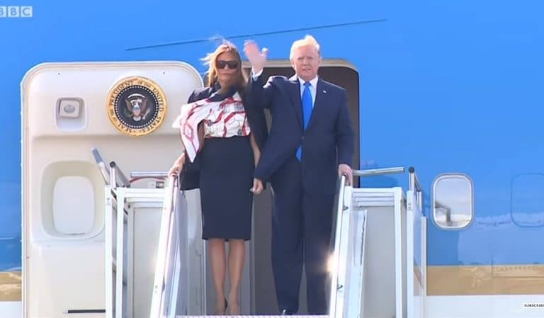 Internet Thinks POTUS Has Health Issues After Video Emerged Of Trump Using Melania's Hand For Support While Walking Down Stairs From Air Force One
