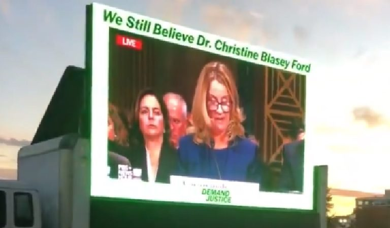 Protesters Blast Kavanaugh Appearance At Event Dinner With Giant Screen Displaying Christine Blasey-Ford's Testimony